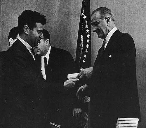 President Lyndon B. Johnson presents Rabbi Richard G. Hirsch with a pen he used to sign the Civil Rights Act of 1966